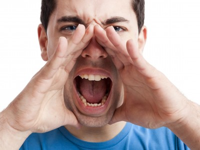 """Side view of an angry, frustrated man yelling at someone"""" Stock ..."""